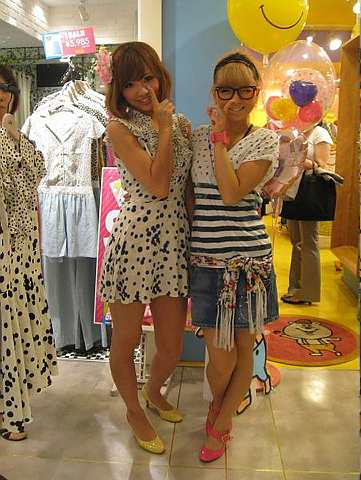 Miku (left) and Natsu pair bright-coloured heels with their Shibuya-trendy attire. Both have bleached hair, and say it is a popular look.