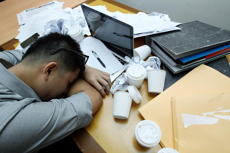 Young and overworked: Young Malaysians in general believe they are being overworked, and that it is having a detrimental effect on their health.