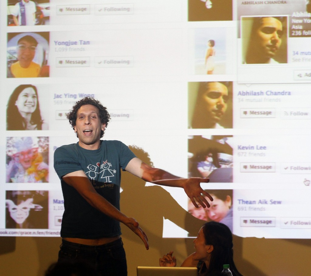 American performance artist Brian Lobel going through his Facebook friends list during Purge, a project that examines modern friendships through social media.