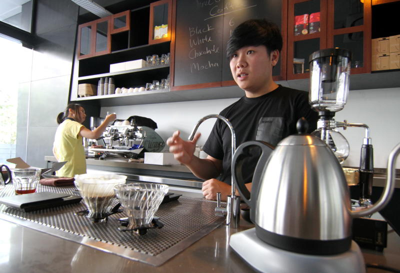The coffee bar at the Three Little Birds cafe looks more like a school science lab. Co-owner Joey Mah has just finished making some filtered coffee worth around RM60 a cup.