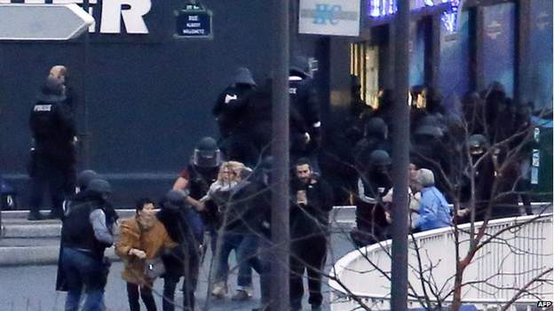 Picture of French police special forces escorting hostages out of the kosher supermarket in Porte de Vincennes. -- Photo by BBC