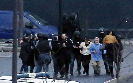 More hostages were evacuated after the French police special forces launched the assault. -- Photo by AFP