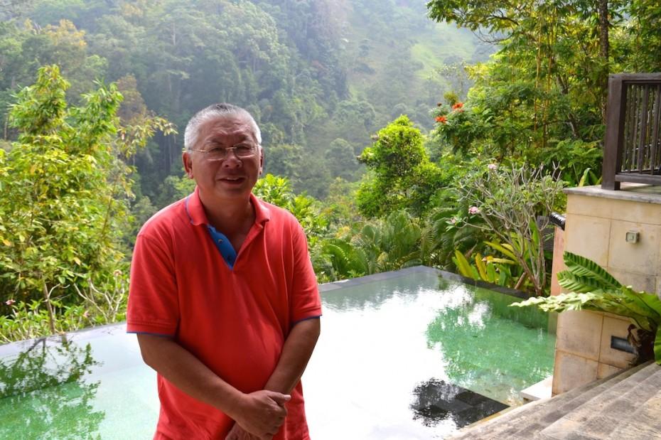 Felix Tee posing for a shot amidst his picturesque eco-villa.