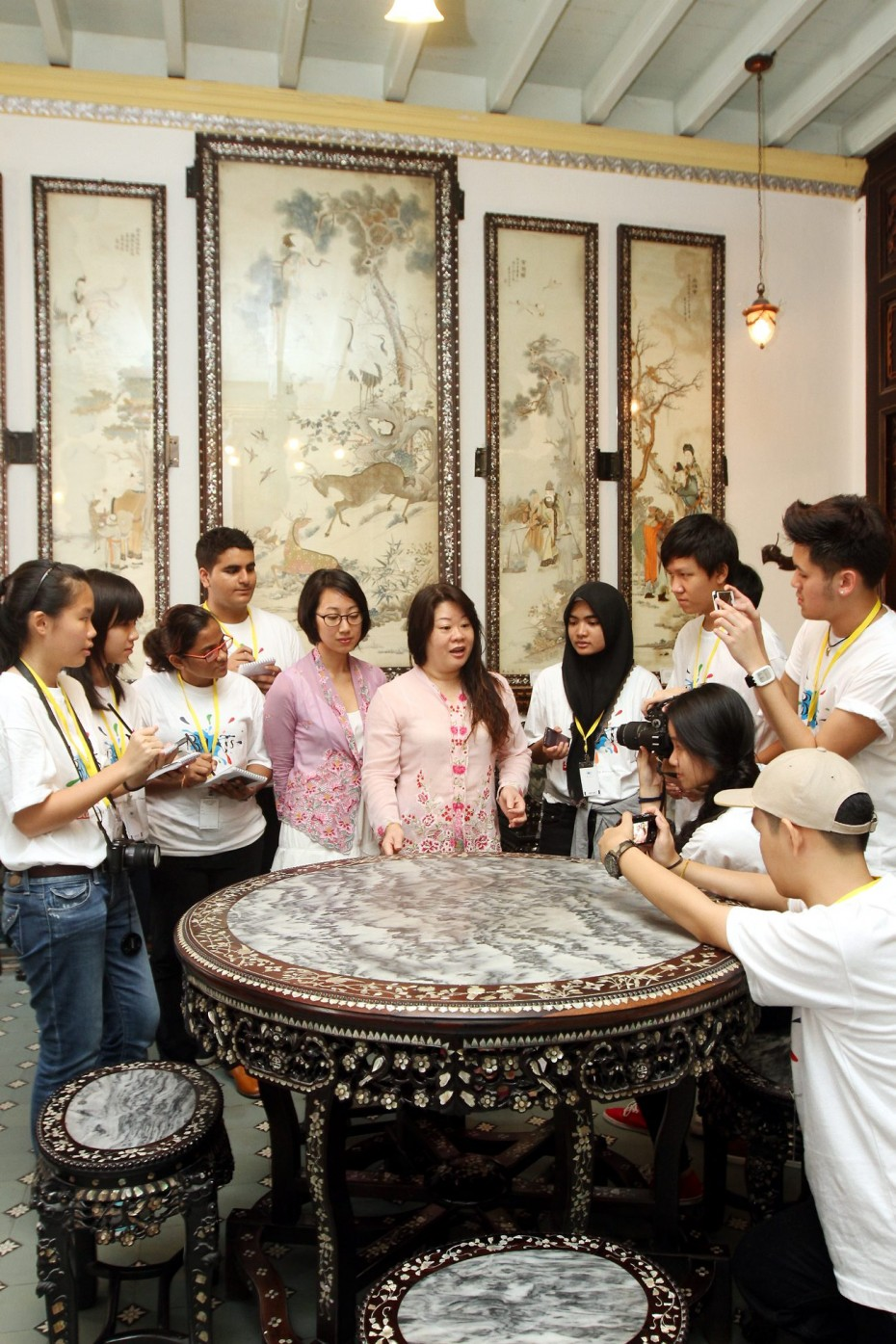 The participants from BRATs Malacca workshop interviewed Baba & Nyonya Heritage Museum curator, Melissa Chan and lead tour guide, Christina Ong. The house, having been in Chan's family for five generations, was turned into a museum in 1985 and it showcases an array of furniture and traditional costumes to provide insight into the lifestyle of wealthy Peranakan families in the past. SAMUEL ONG / THE STAR, 18TH SEPTEMBER 2014.