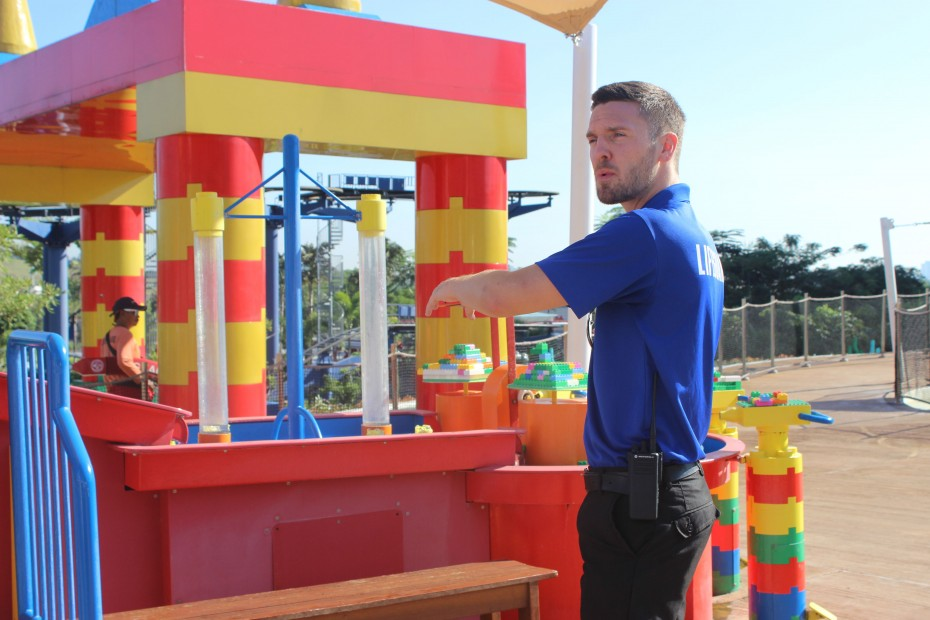 Besides the guests' safety, Harrison aims to educate the kids by expanding their imagination and creativity. Here, he is at the Imagination Station, where kids are encouraged to build Lego models out of the DUPLO bricks.