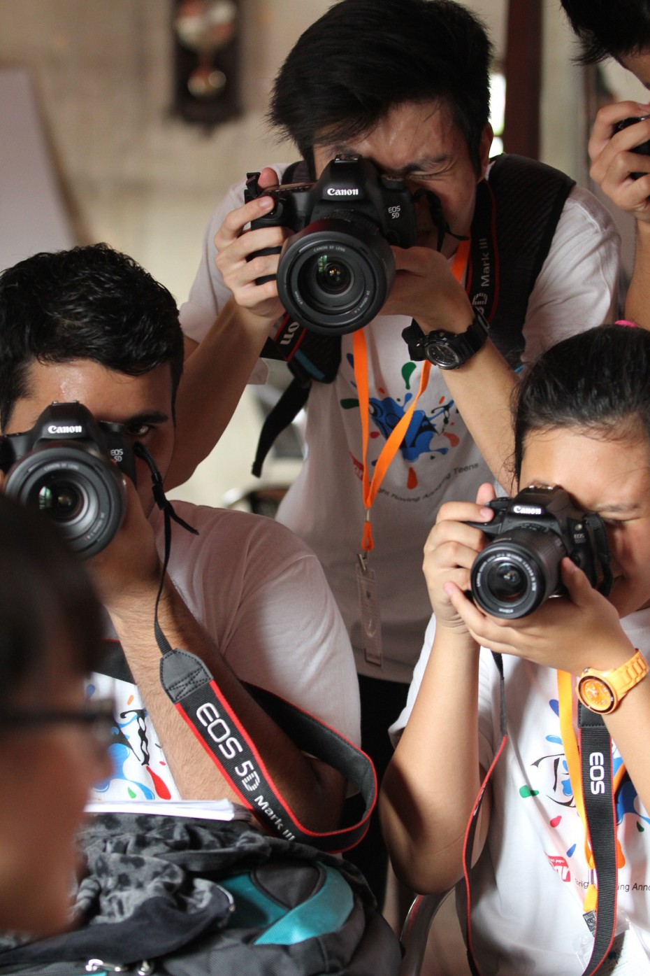 Some of the participants putting their new-found photojournalism skills to the test.