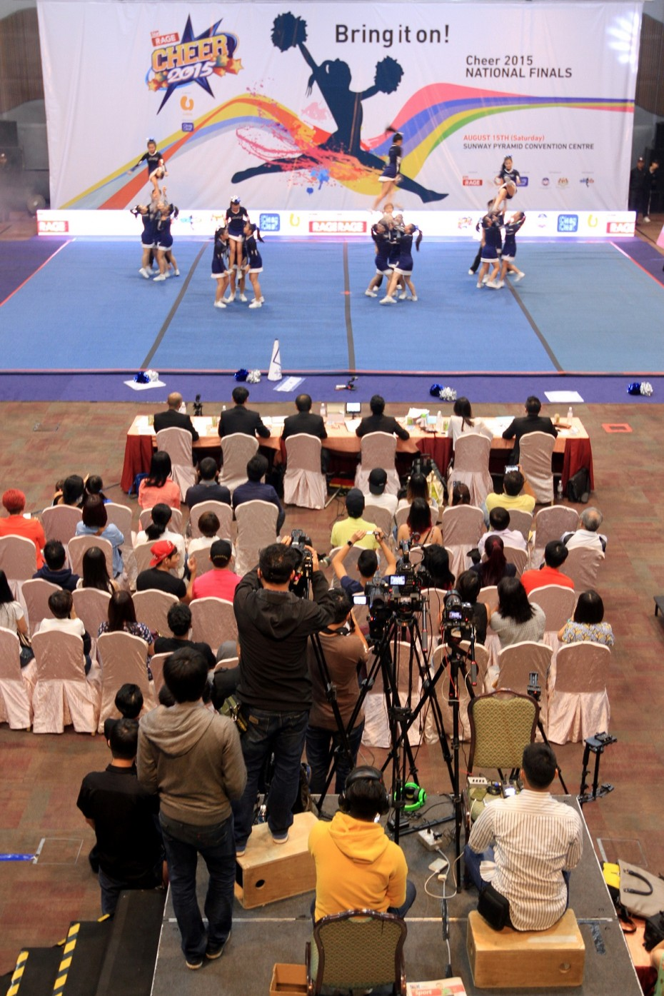 The video crew worked non-stop, making video after video of each of the 39 team's three-minute routines. This was then edited and uploaded on the R.AGE website in less than 10 minutes. -- Photo: SAM THAM/The Star