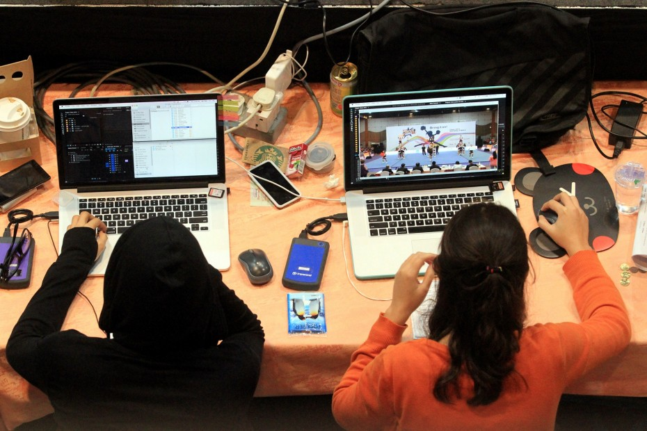The video editors at CHEER 2015 worked tirelessly to fine-tune and hone the teams' performance videos and got each one done in record time! -- Photo: SAM THAM/The Star
