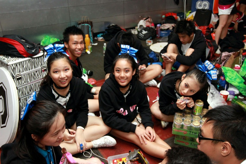 The cheerleaders spent a lot of time practising and waiting for their turn on the mat, but were kept refreshed with the help of Pokka green tea.