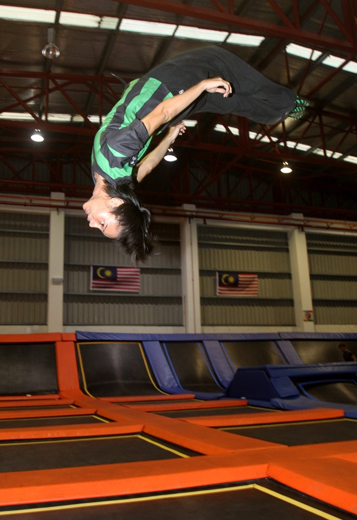 Stunts like backflips require a certain level of skill, and you can learn how to at Jump Street Trampoline Park. — AZHAR ARIF/The Star