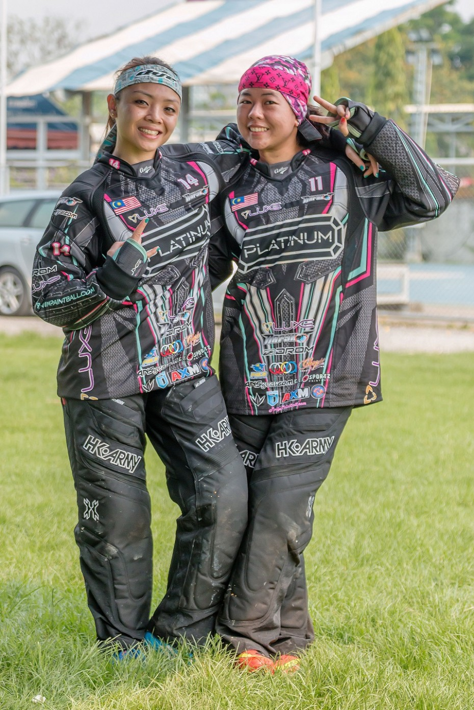 Paintballer Hanna (left) poses with her teammate, Azrin Ishak who introduced her to the sport two years ago. --
