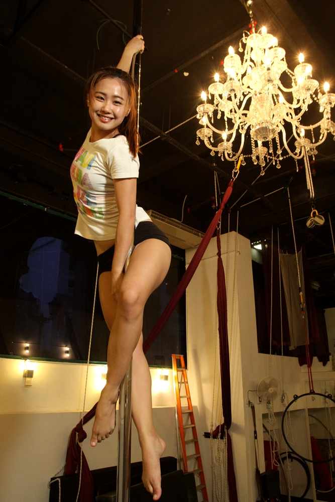 Tan's family were initially skeptical of her being involved in pole dancing, but they gave their full support after watching her perform. — RAYMOND OOI/ The Star