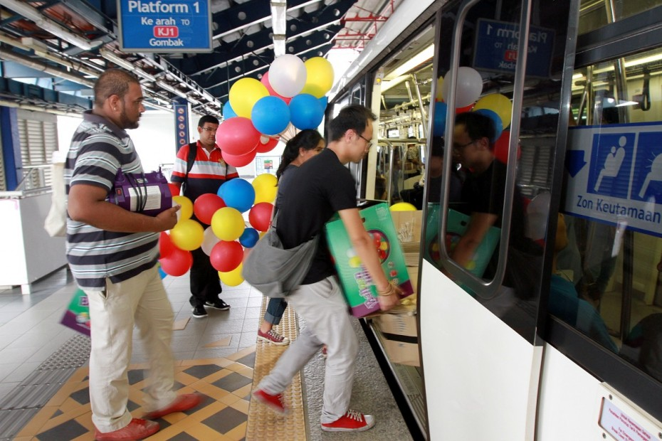 Participants load the trains with all sorts of goodies ahead of the train party. Photo: LOW LAY PHON/The Star