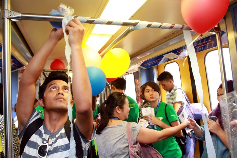Organisers of campaign Seeding MY Hope decorate the coaches ahead of the train party. Photo: LOW LAY PHON/The Star