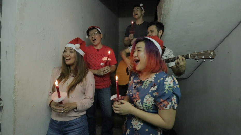 Singers Chelsia Ng (left) and Bizhu (right) giving a surprise performance to a Christian Pakistani family seeking asylum in Malaysia.