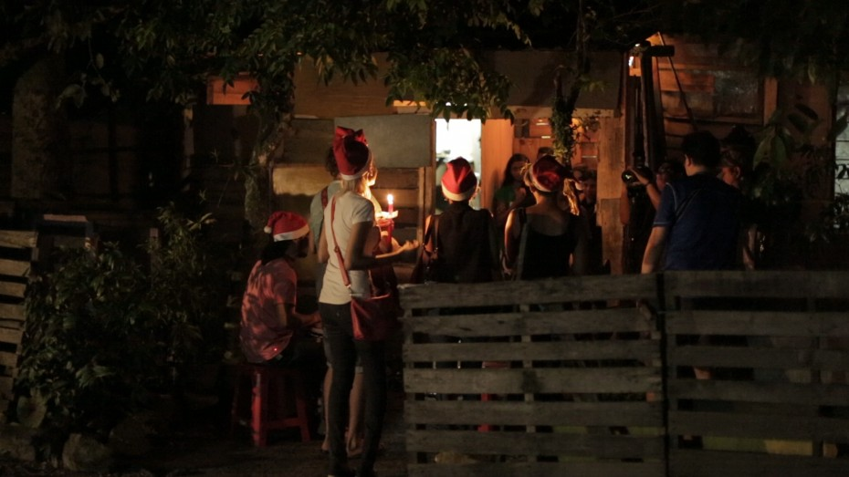 The carollers singing outside of Mariyammah's home