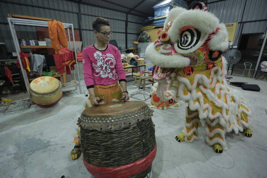"Janson Chan, 16, from the E-Xin troupe, is one of the youngest members in his troupe. ""Joining lion dance kept me from getting into trouble,"" he said."