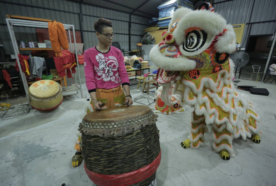 "Janson Chan, 16, from the E-Xin troupe, is one of the youngest members in his troupe. He joined 11 years ago, under coach Kent Wong's wing. ""Joining lion dance kept me from getting into trouble,"" he said."