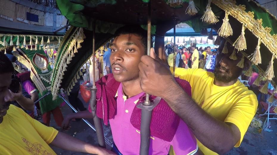 Kavadi porter Rajvarman, 15, preparing to carry a kavadi back down the temple at Batu Caves. -- Photo: ELROI YEE/The Star