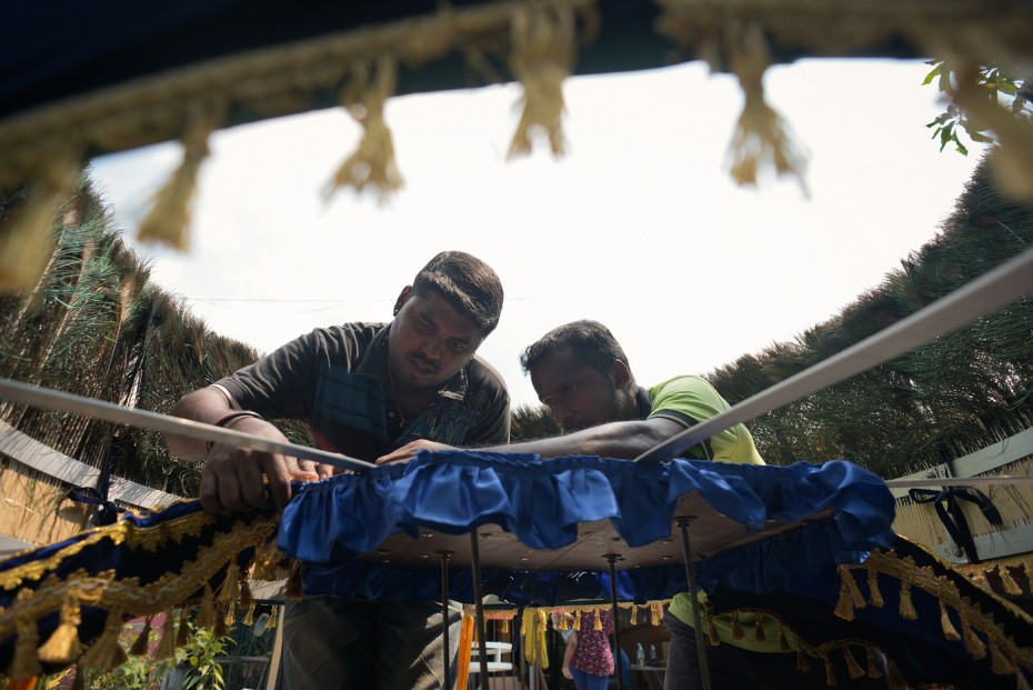 Kishor (left) volunteered to help build a kavadi. He was also a kavadi porter at Thaipusam. — Photo: ELROI YEE/The Star