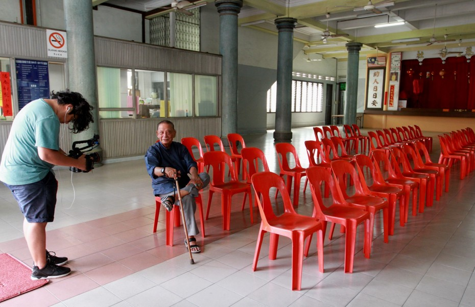 "Carvalho at the Meng Seng building, a charity hall turned into a torture chamber by the Japanese. Carvalho said his uncle was tortured here, simply for listening to the radio. He said it was a ""house of hell""."