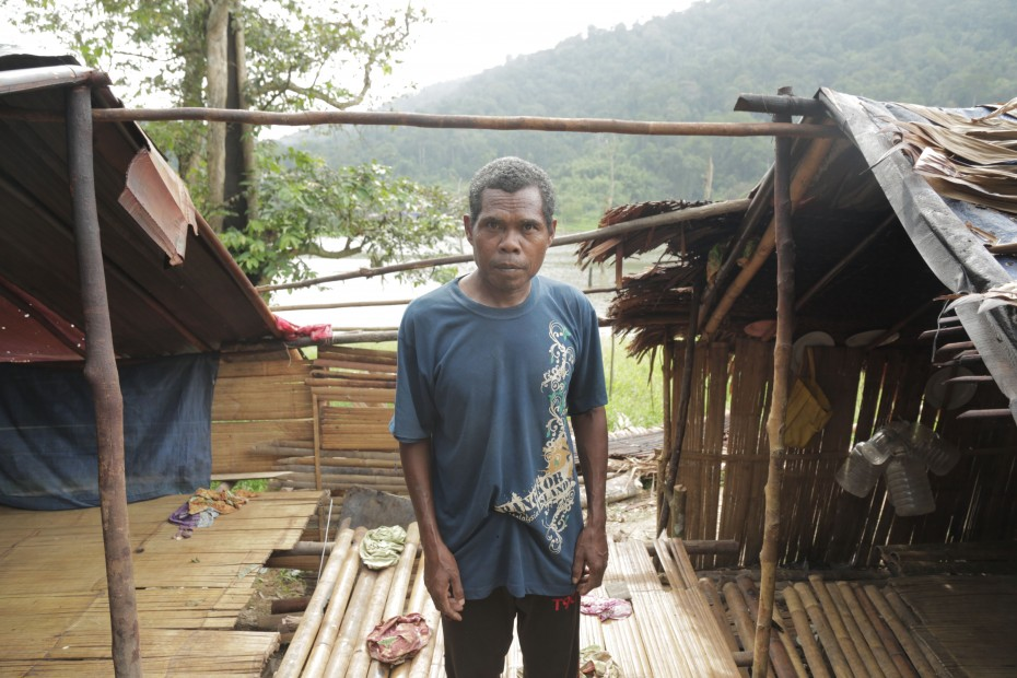 Kederi, an orang asli, standing in the middle of his home, which was torn apart by an elephant. It stuck its trunk into the hut, looking for food.