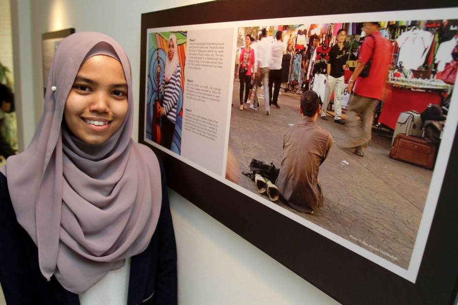Nur Aisyah, who is from Myanmar, said this photo she took of a disabled beggar on the streets of Chow Kit is a bleak reminder of the situation in her home country. 2 Kamal, a volunteer at KL Krash Pad, had been giving refugee and undocumented children photography lessons to empower them. 3 The children at KL Krash pad, aged 16-18, are given vocational and educational training. 4 Some of the KL Krash Pad children performing at the launch of the exhibition, where a music video they produced is also being played. Photos: YAP CHEE HONG/The Star