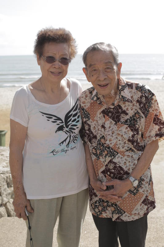 Ethelin Teo and her husband are all smiles as they pose at Teluk Cempedak beach.