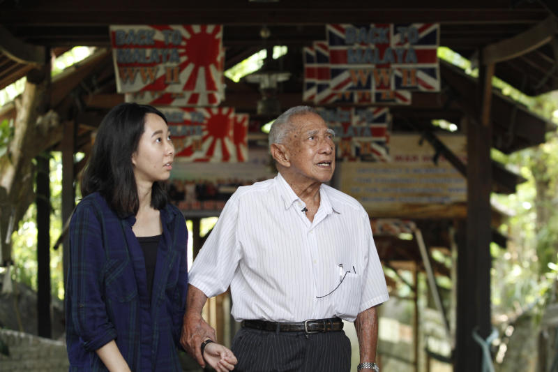 Jeremiah and R.AGE journalist Vivienne Wong walk through the old fort at Batu Maung, now a museum.