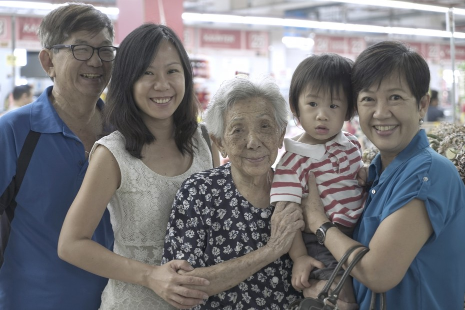 Four generations in one picture: Tan (in white) says Low (centre) likes to revisit Salak South from time to time.