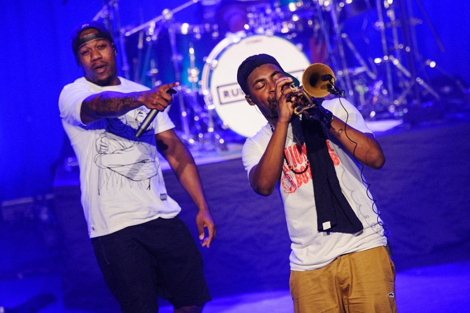 Rolle (left) is one of four core members in Rudimental. The band performs live with a group of touring musicians, which includes trumpeter Mark Crown (right).
