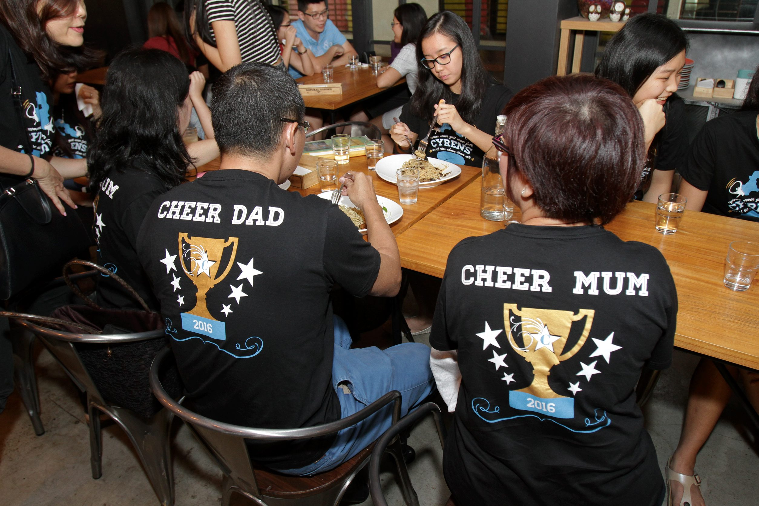 Even the parents of the girls have their own Cheer Mom and Cheer Dad T-shirts.