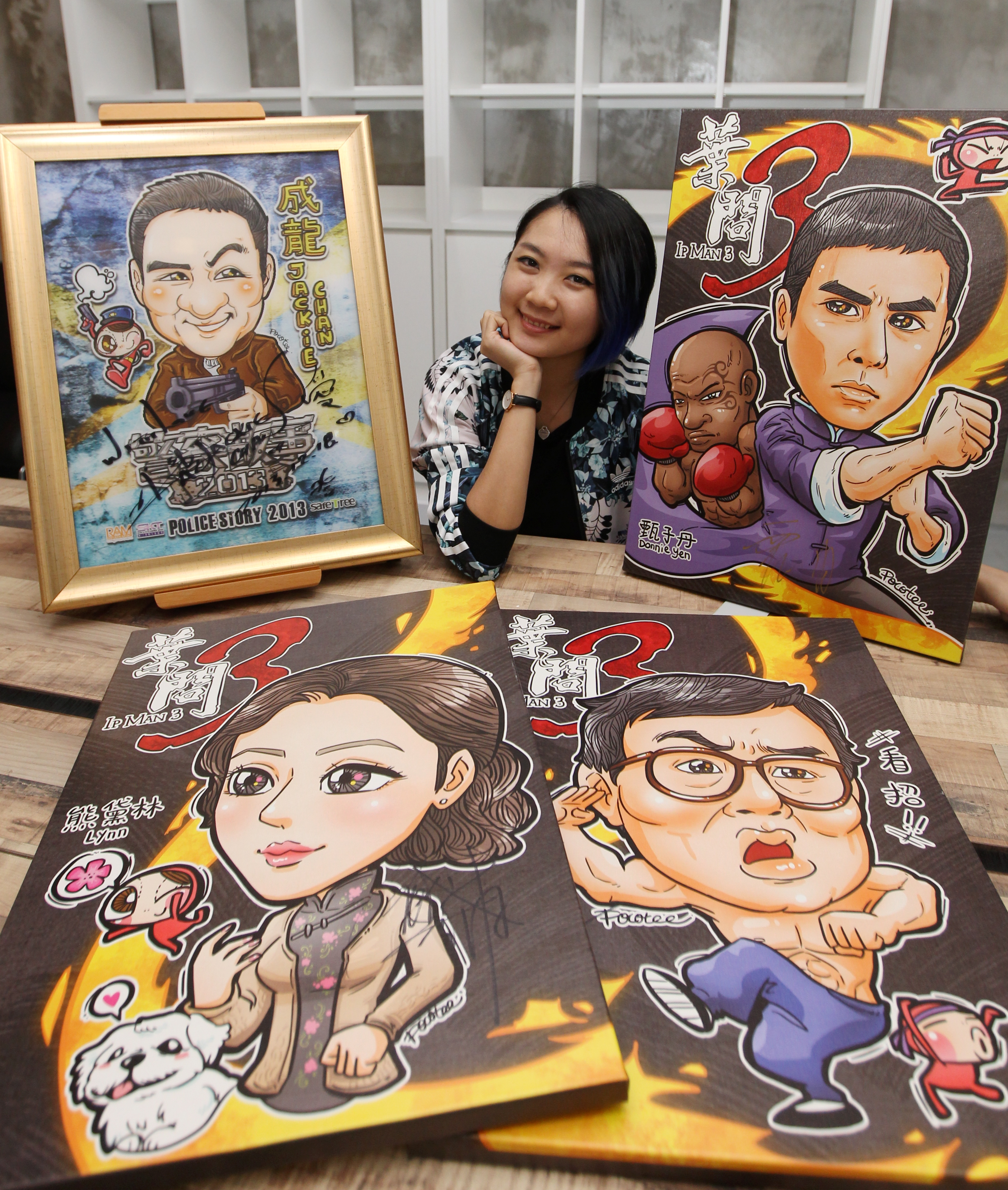 Loh mostly draws posters for Hong Kong movies because, according to her, Malaysia hasn't caught the trend yet.