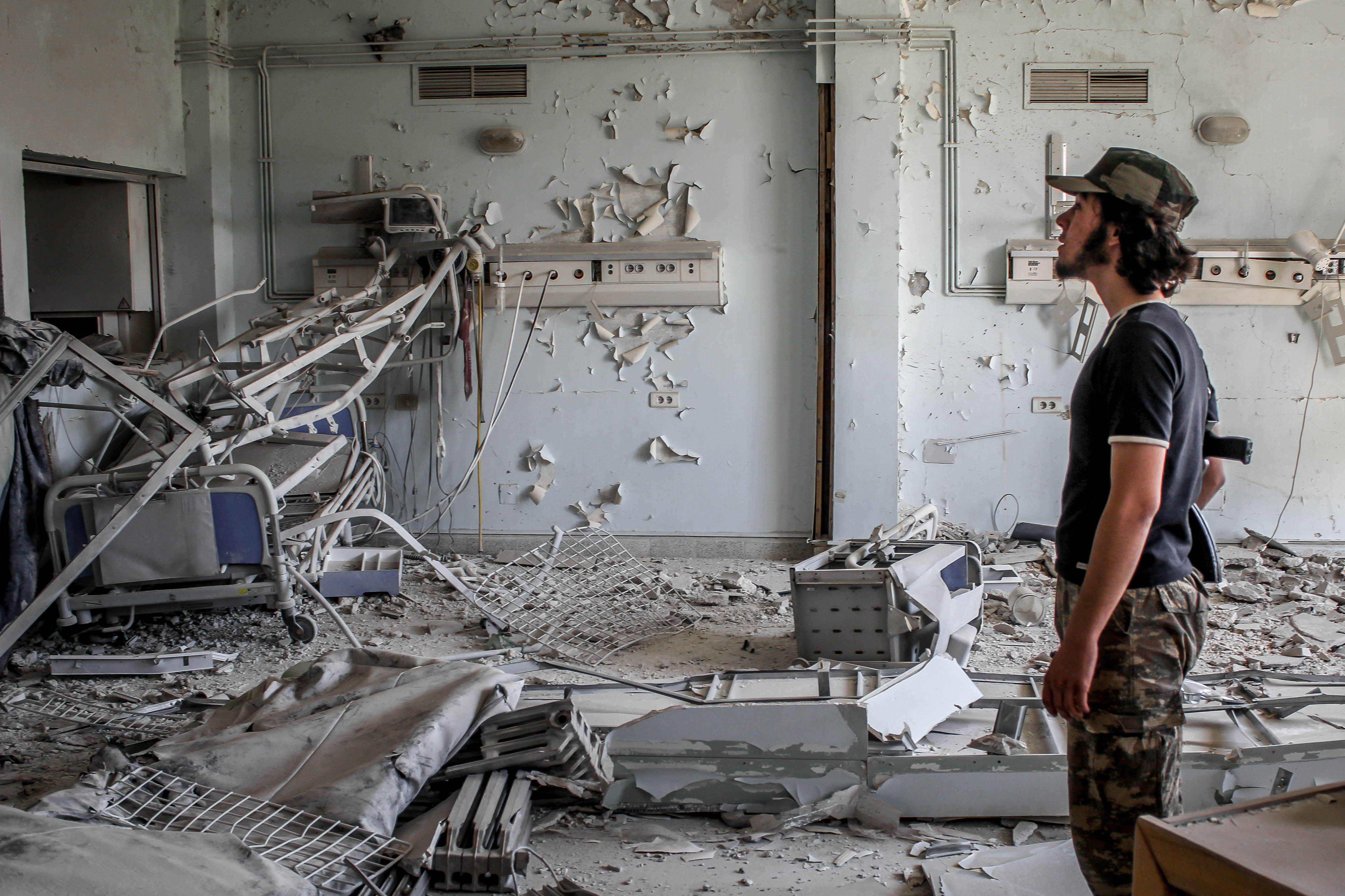 A man surveys the remnants of a Syrian hospital after an airstrike. Lau hid in the basement with the hospital staff until it was over. Photo: Chris Lau.
