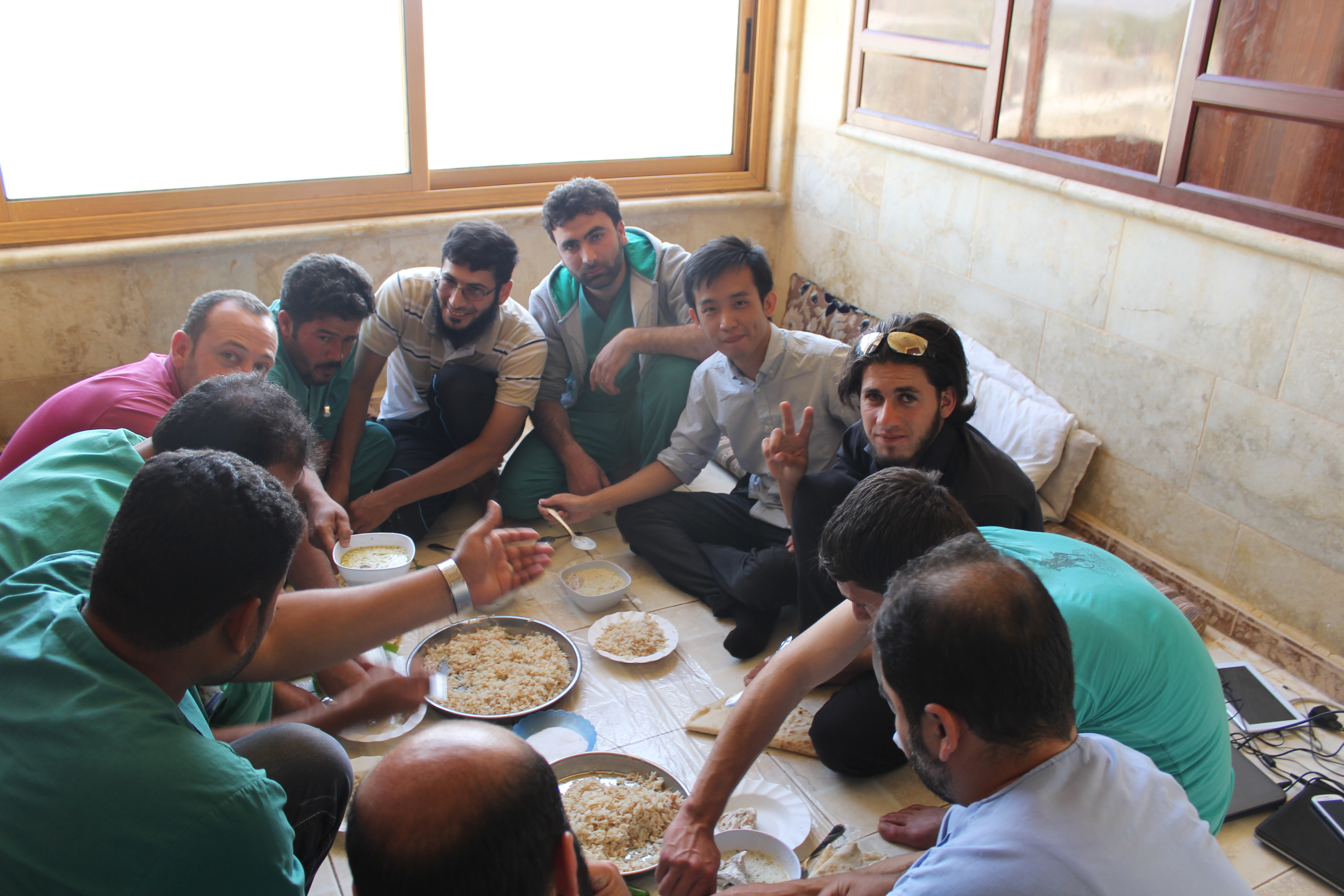 Taken in 2014, this picture shows Lau eating with the staff of a Syrian hospital. He admires their bravery, and the will to persevere despite all the fighting and airstrikes.
