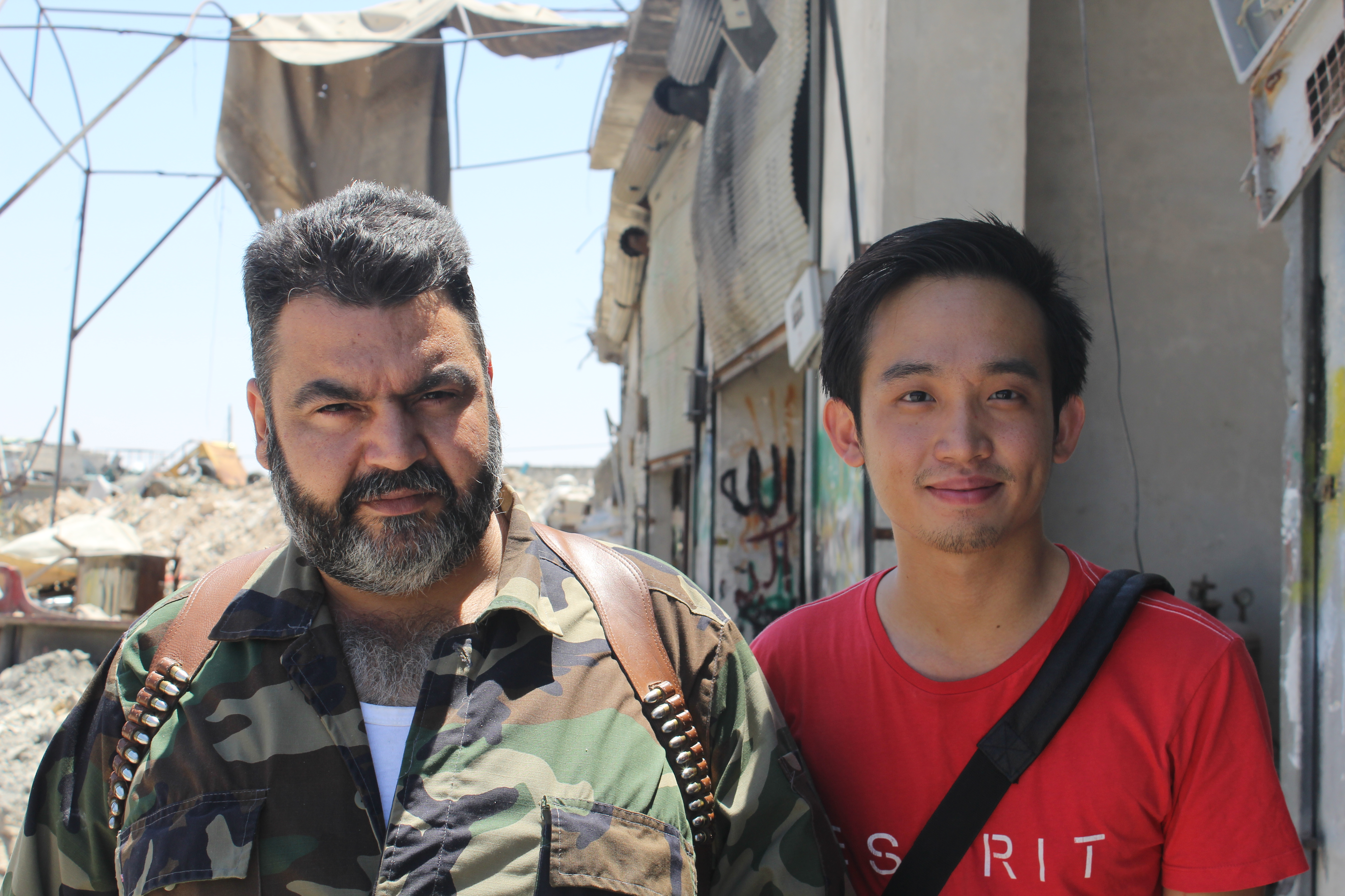 Lau with one of the commanders of the Free Syrian Army in 2012. The NGO that hosted him was based on the rebel-held part of Aleppo. Photo: Chris Lau.