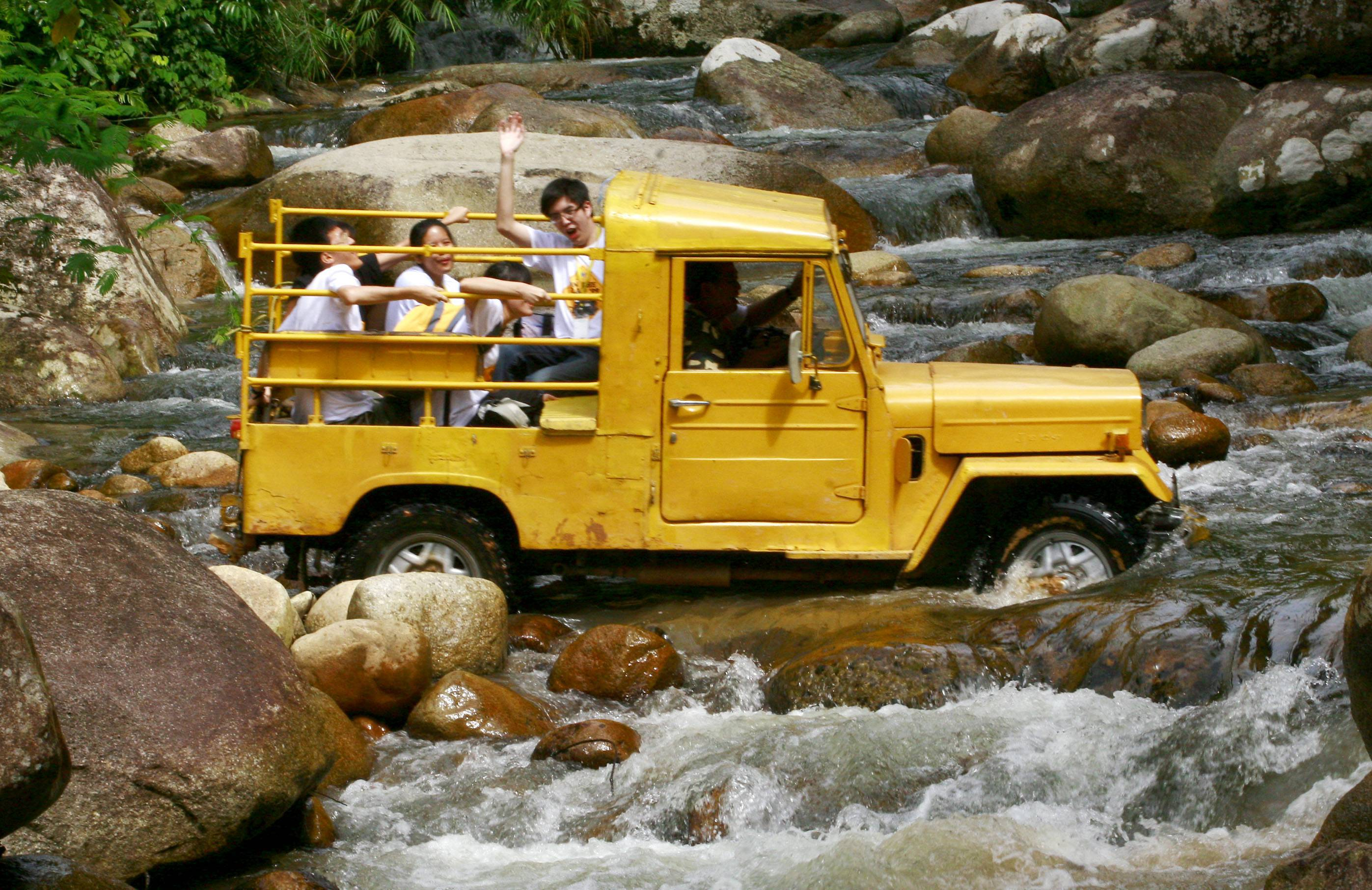 The BRATs being taken to the Lata Berembun waterfall in the back of a four-wheel-drive truck. They got in touch with nature and had the time of their lives going off-road during the year-end camp. ― Photo: CHAN TAK KONG/The Star