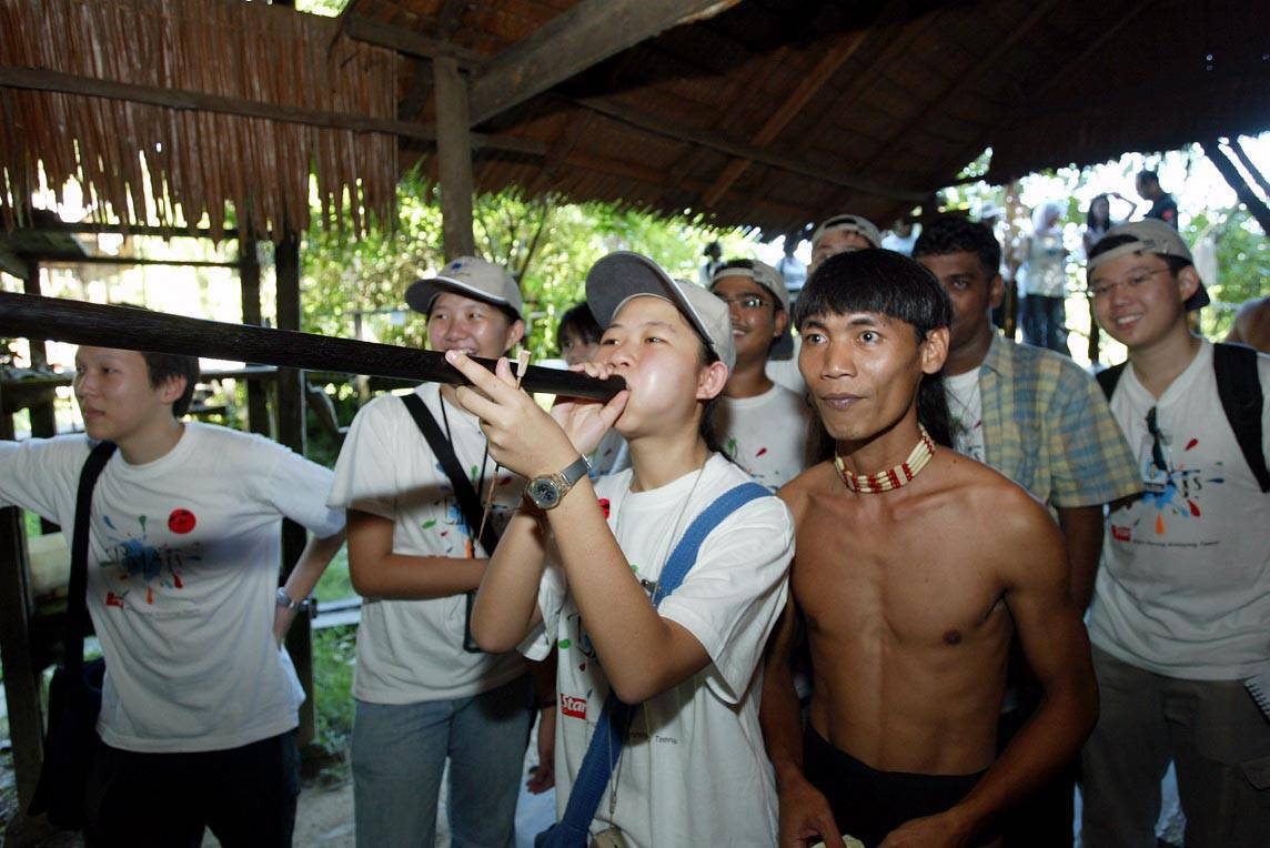 A BRATs participant learning to use the blowpipe under the guidance of a Penan native at the Sarawak Cultural Village in 2004. ― Photo: RAJA SHAMSUL BAHREN/The Star