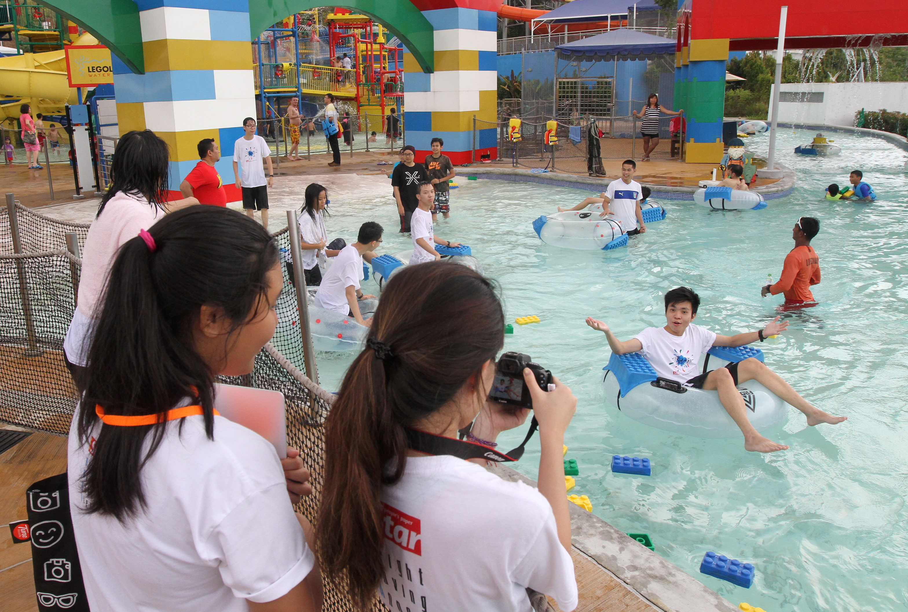 The BRATs having a splash in Legoland Johor while working on their assignments with the staff at the theme park. - Photo: AZLINA BT ABDULLAH / THE STAR