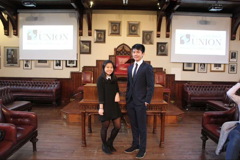 Ji (left) and Tan at the Main Chamber of Cambridge Union; they beat 15 other Malaysian teams in the regional competition to be the first Malaysians to set foot there. — Handout